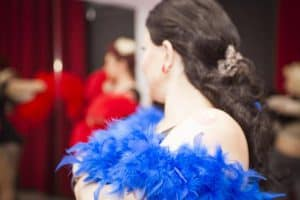 Performer with feather boa