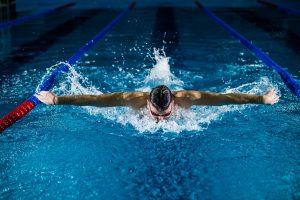Man Swimming Butterfly in swimmingpool