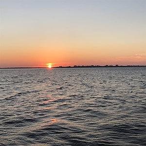 Sun setting on the water. Sunset cruise Charleston, SC