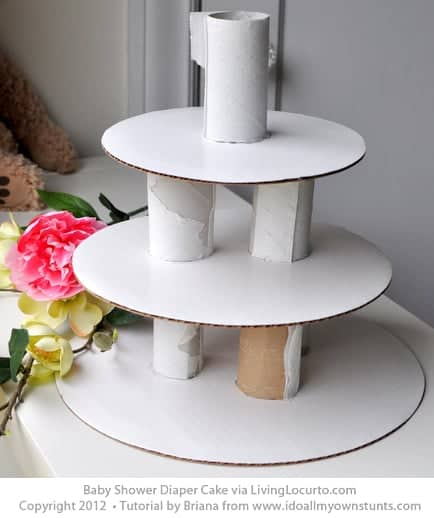 How to make a Baby Shower Diaper Cake. Simple step-by-step craft tutorial. Perfect for a party or baby gift. LivingLocurto.com