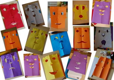 têtes en papier réalisées par les enfants de la classe de Marie-Laure