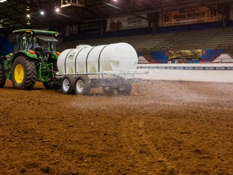 Tractor Pulling 1600 Water Trailer In A Horse Arena