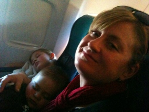 sleep on a plane, flying with toddler, traveling with kids, sunwing with baby