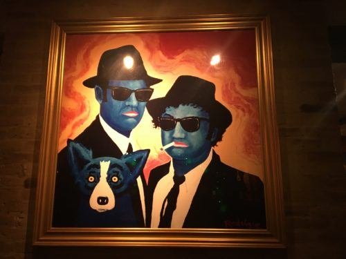 The blue dog with the blues brothers at the dog's eponymous lafayette café