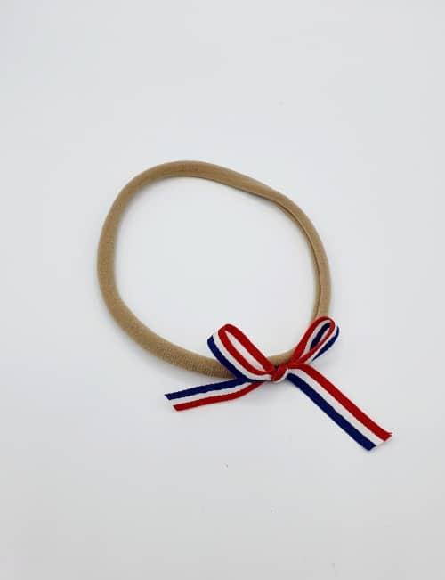 Nylon haarbandje rood wit blauw strikje