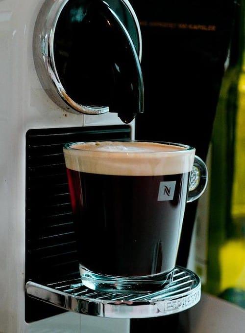 Long espresso on the drip tray of a Nespresso machine