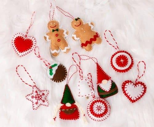 felt ornaments on a white fur background.