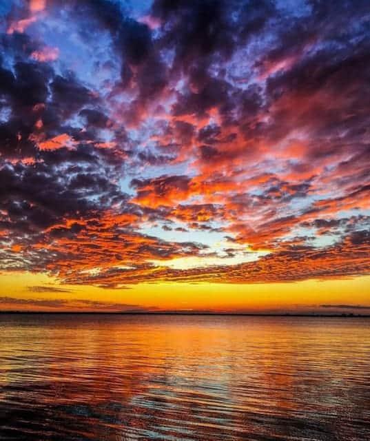 Beautiful sunset with many colors including blue, orange, yellow, purple, pink. Sunset cruise Charleston, SC