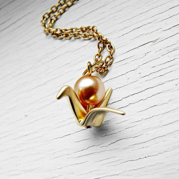 Gold paper crane necklace with bronze pearl