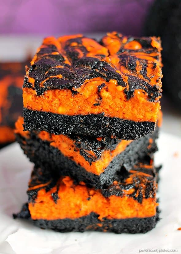 Creepy Crawlies Swirl Cream Cheese Brownies have a layer of rich, dark chocolate brownie topped with a layer of orange cheesecake then swirled together for a spooky treat