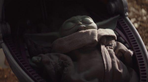 Baby Yoda asleep in his travel crib