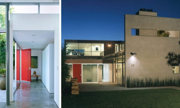 go for a minimalist house with simple red doors, concrete gray floors, and white walls