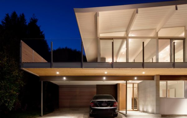 attach the carport with a second-floor deck for a seamless and contemporary front of house