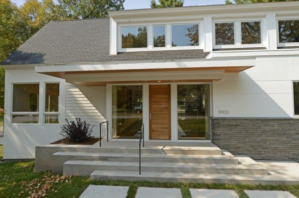 evoke a modern architectural design and dramatic flair with staggered concrete front steps and asymmetric railings