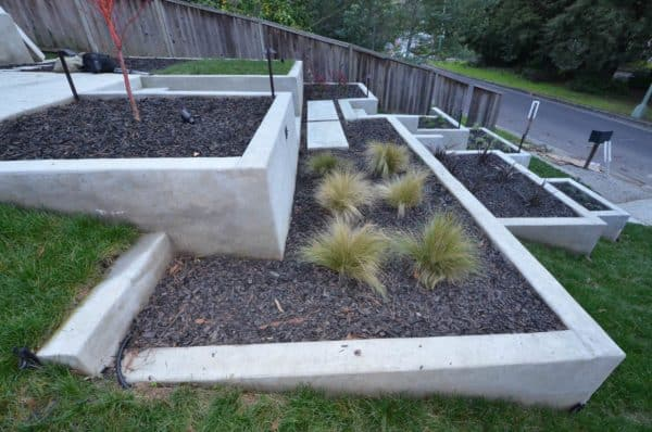 create a multi-level garden and concrete retaining wall for a unique and refreshing front yard