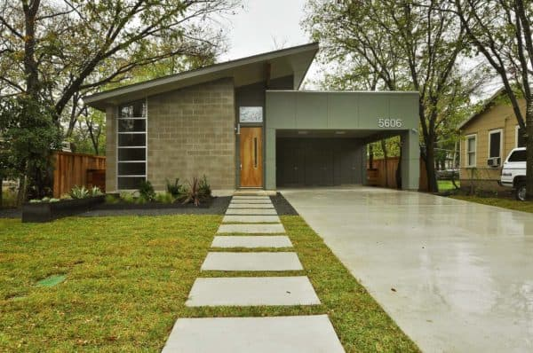 simple concrete carport for a modern mid-century house and timeless front