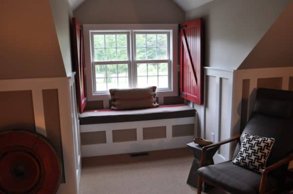 paint barn door window shutters in bold red color for a cottage-style window seat