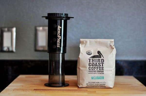 AeroPress next to a bag of Nicaraguan coffee beans