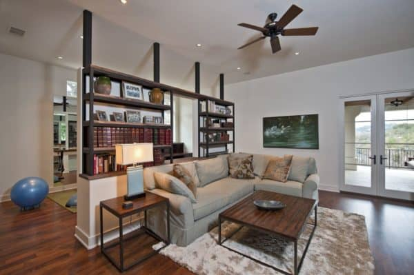 half wall industrial bookshelf divider with antique books for a traditional and homey family room