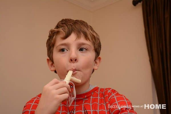 Joshua eating Marvel Spider-Man String Cheese