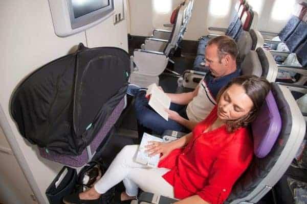 airplane bassinet, airline bassinet, which airlines offer bassinets for infants, bassinet cover, airplane bassinet cover, carrycot cover, travel cover for stroller