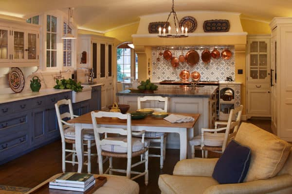 traditional and cozy french provincial kitchen fuses royal blue furniture and yellow paint