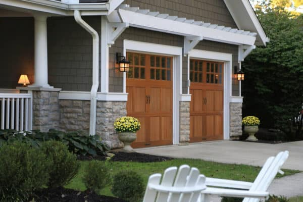 classy and natural barn style garage doors with sophisticated glass windows in a modern home