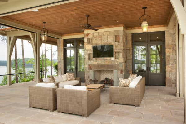 country estate living room featuring stone wall fireplace and indiana limestone tile floor