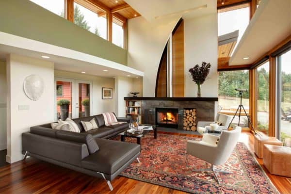 gray tile accent in front of stunning natural fireplace in a contemporary living room design