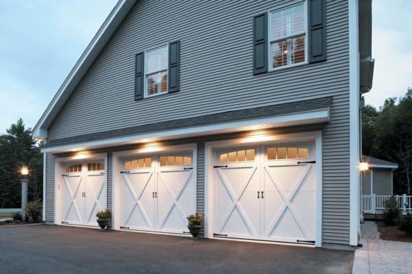 large white barn style garage doors on a gorgeous farmhouse design