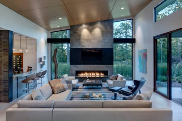 build a modern and luxury nest featuring lagos blue stone in the linear fireplace and ebony veneer for the tv surround