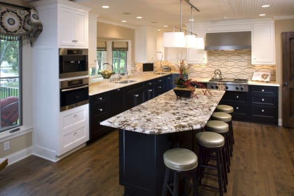 create a trendy kitchen with curtains over the kitchen bay window and beige backsplash design