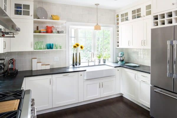large bay window over sink in an all-white kitchen for a bright and modern atmosphere