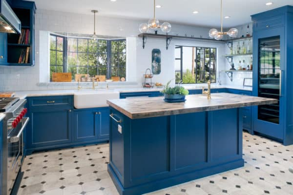 pair your wiry bay window over the sink with wooden decor and attractive skiffkey blue cabinetry