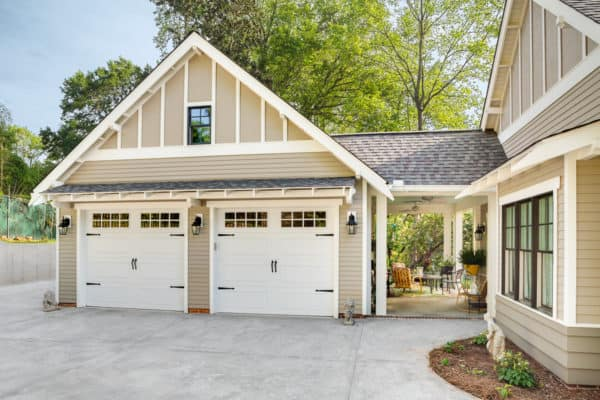 use breezeway as semi-outdoor nook in a craftsman mountain home with detached garage