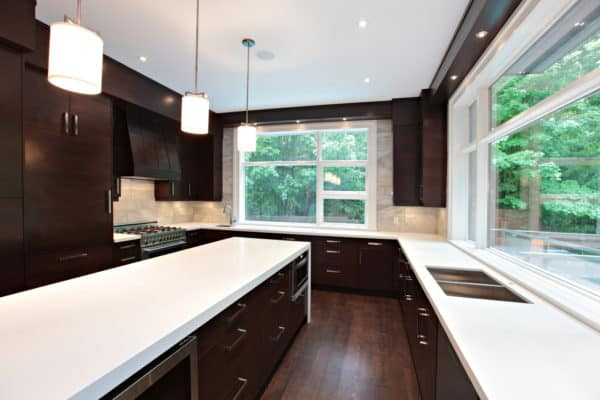 go for a contemporary look with light brown backsplash and glossy white countertops