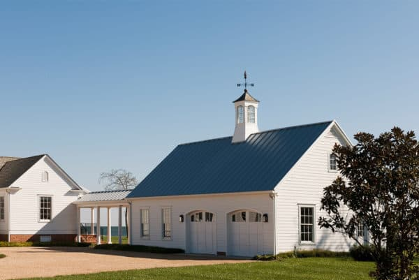 build a cottage-inspired home with a detached garage, breezeway, and charming cupola