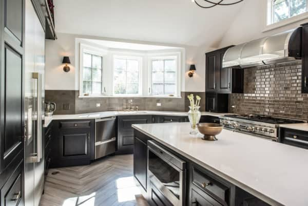 choose a luxurious kitchen featuring maple wood, quartz, onyx finish, and a bright bay window over the sink