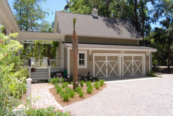 embrace country living with this detached garage design in sandbar and a gorgeous breezeway