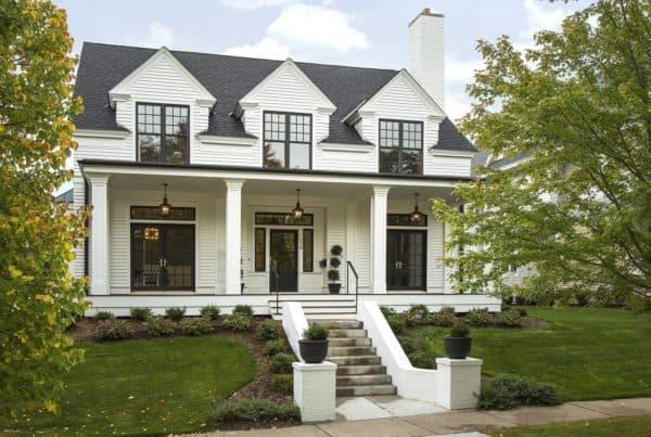 modern colonial white house and huge elegant black windows