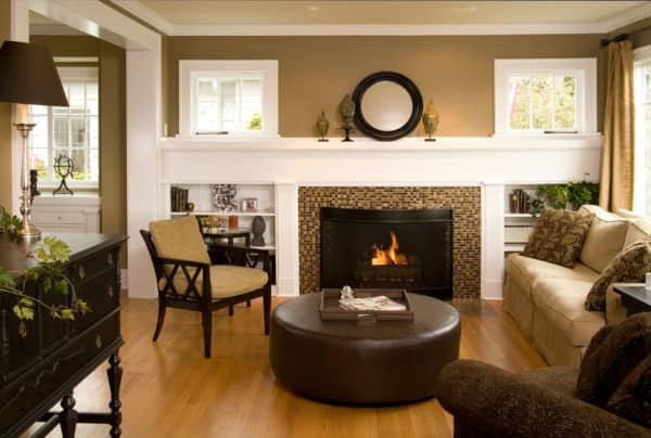 elegant living room with tile fireplace and matching tile floors in front of it