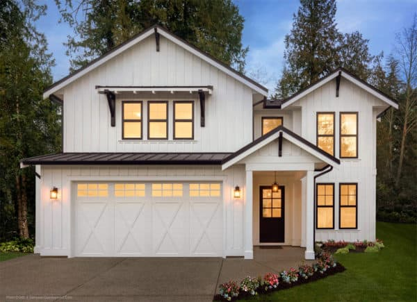 carriage style garage door with a barn house ambiance in this stunning all-white house
