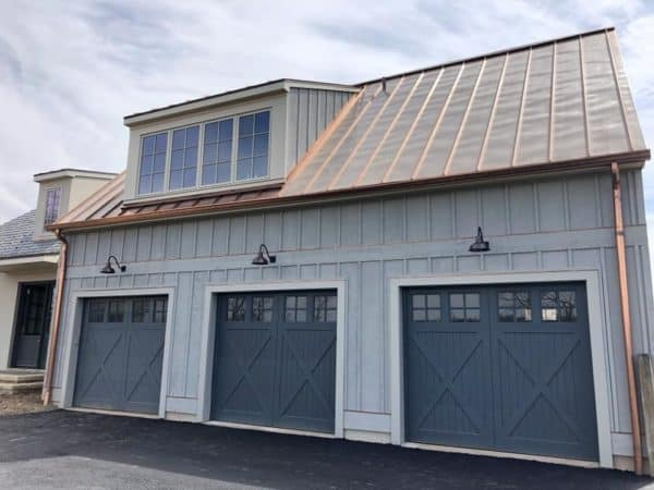 lifting faux wood garage doors in a farmhouse style home inspired by classic barn elements