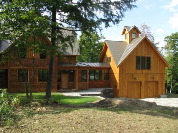 create a charming rustic vibe for your detached garage and breezeway with wood exterior and metal roof