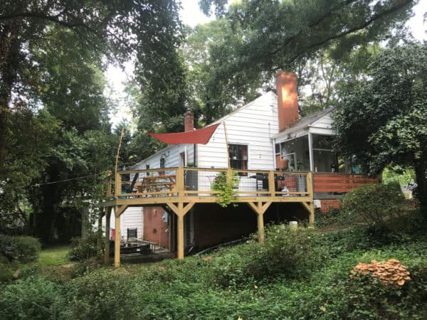 build a beautiful home featuring a rustic second-story deck with metal railing and siding