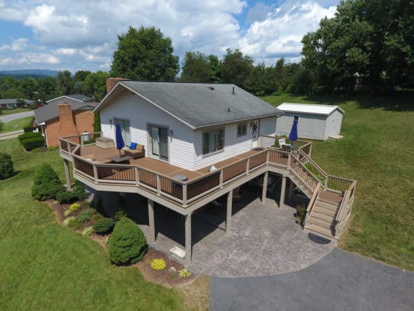 go for a wrap-around second-story deck with vinyl railing for a spacious entertainment area