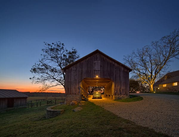 make a stunning farmhouse carport with natural wood structure and gravel driveway