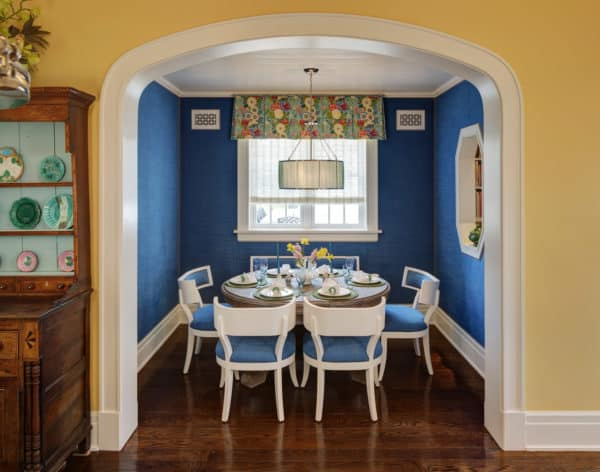 contrast royal blue with amber yellow walls for a classic kitchen and dining room