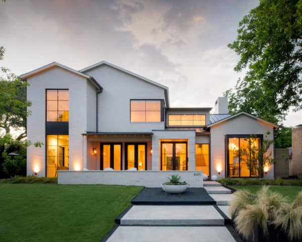 glass windows with aluminium black trim contrasted with white painted brick house