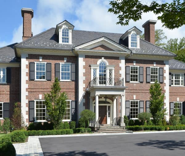 unfading gray color slate roof looks gorgeous on a classic georgian red brick house